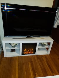 flat screen TV and white wooden TV stand Medford