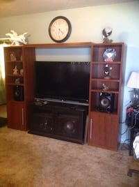 Brown wooden hutch only. Tv it's not including
