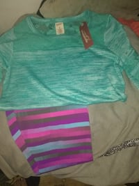 teal scoop-neck shirt with multicolored pants