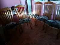 five gray fabric padded brown wooden base chairs