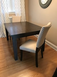 """Solid wood dining table, seats 6. Extension leaf included, seats 8. It measures 5FT long x 42"""" and 78""""x42"""" with extension leaf. Chairs not included"""