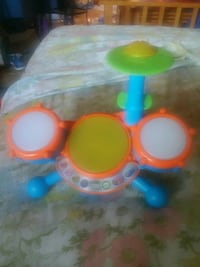 children's green, blue, and orange learning musical drum toy