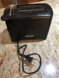 black and gray Bose portable speaker 558 km