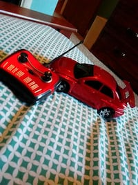 black and red RC sedan with controller