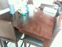 rectangular brown wooden table with four chairs dining set Richmond, 23233