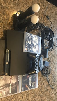Sony PS3 slim console, controllers, playstation move and three games Skokie, 60077