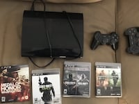 PlayStation 3 with 2 controllers and 5 games  Orange, 92866