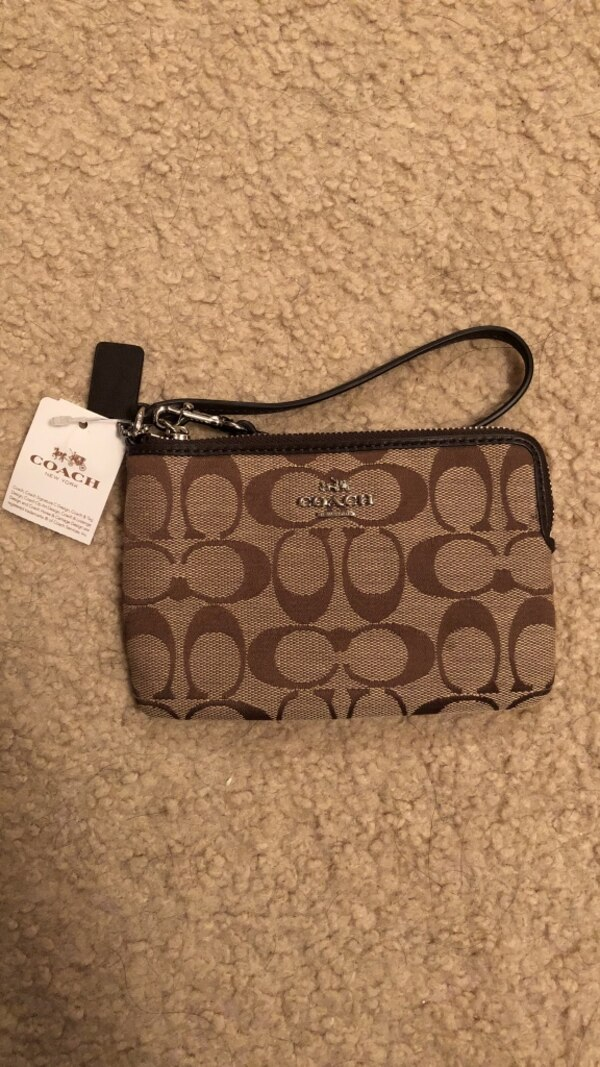 Monogrammed brown and black coach wristlet