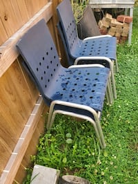 Chairs stackable- hard plastic  blue with metal frame .a total of 4