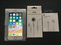 Rose gold iPhone 7 with charger and headphones  Las Vegas