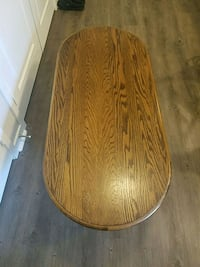 brown wooden round table  Parker