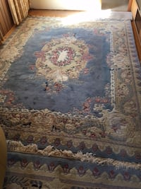 Blue and white floral area rug. There are 2 rugs each 9'x12'.  Price is per each.  If you buy both we will sell for a total $1000.