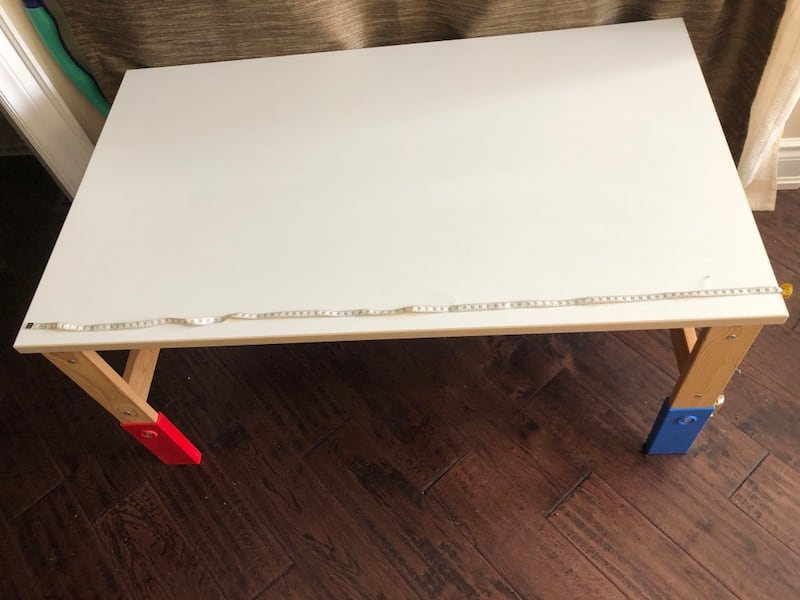 wooden table with one chair Ikea 8e9c7b14-43e1-4185-af9d-460c01efd922
