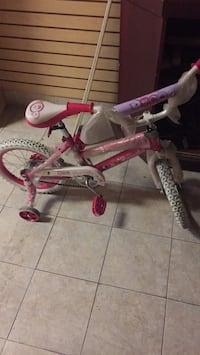 Toddler's pink and white bicycle with training wheels Baltimore, 21202