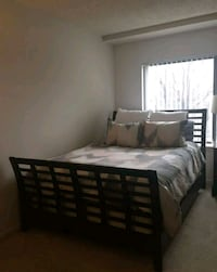 black wooden bed frame with white mattress Chevy Chase, 20815