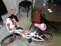 two white bicycles with training wheels