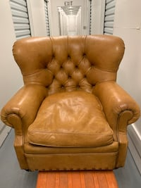 Really expensive high end tufted leather chair