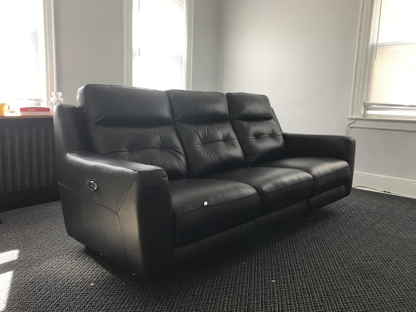 All black leather couches Electric powered +4 USB ports