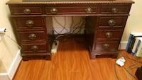 brown wooden single pedestal desk Alexandria, 22301