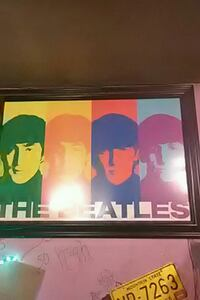 The Beatles poster with brown frame Charleston, 25311