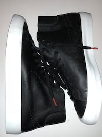 black-and-white Nike leather high-top sneakers