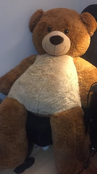 Brown and white life size bear plush toy