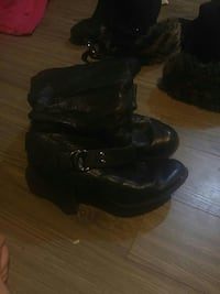 pair of black leather boots Calgary, T2K
