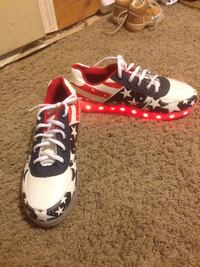 Red, white, and blue led low top sneakers