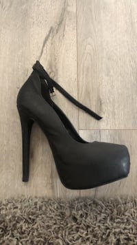 Black stiletto platform heels with ankle strap. Closed toe.  Huntington Beach, 92648