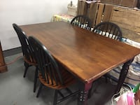 3'x5' rectangular brown wooden table with four chairs dining set