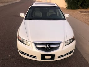 Acura TL With only 134k miles, it's Pearl white with light gray leather interior.