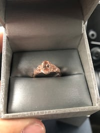 Women's rose gold engagement ring.