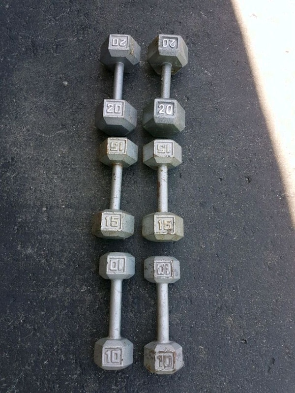 two gray fixed weight dumbbells