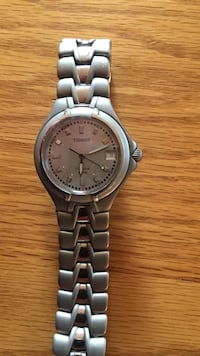 Round silver-colored tissot analog watch with silver-colored linked bracelet 310 mi