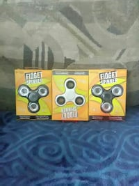 three black and gray fidget spinners with pack Reno, 89502