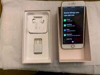 gold iPhone 7 with box, USB power adapter, and EarPods 43 km