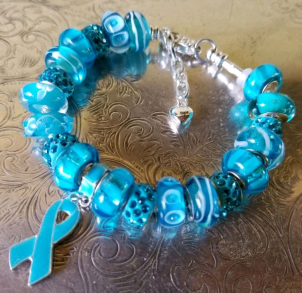blue and silver beaded bracelet 21e7606c-34bf-407a-8c51-b7bc91b728c4