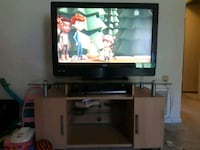 flat screen television with brown wooden TV stand Baltimore, 21234