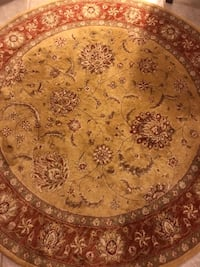 round red and beige floral area rug