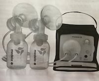 white Medela dual electronic breast pump set