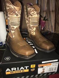 Pair of brown leather cowboy boots Houston, 77037