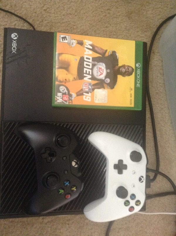 Xbox one console with controller and game cases