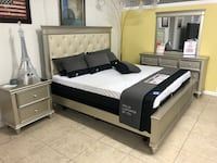 gray wooden bed and white and black mattress Houston, 77084