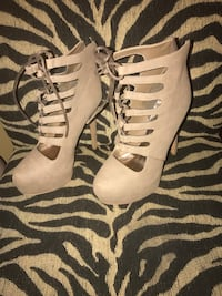 Pair of women's gray leather stilettos