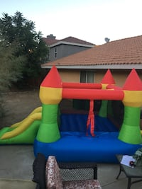 green, red, and blue inflatable castle
