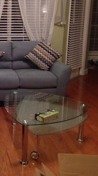 Glass coffee table with swivel bottom