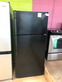 Black GE Top Freezer Refrigerator  47 km
