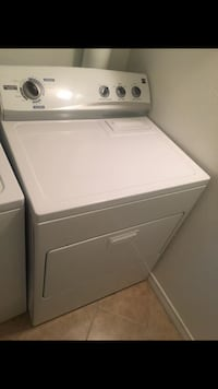 White Whirlpool top-load clothes washer