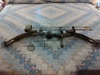 brown and black compound bow 68 km