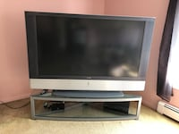 Gray flat screen television with remote Hewlett, 11557